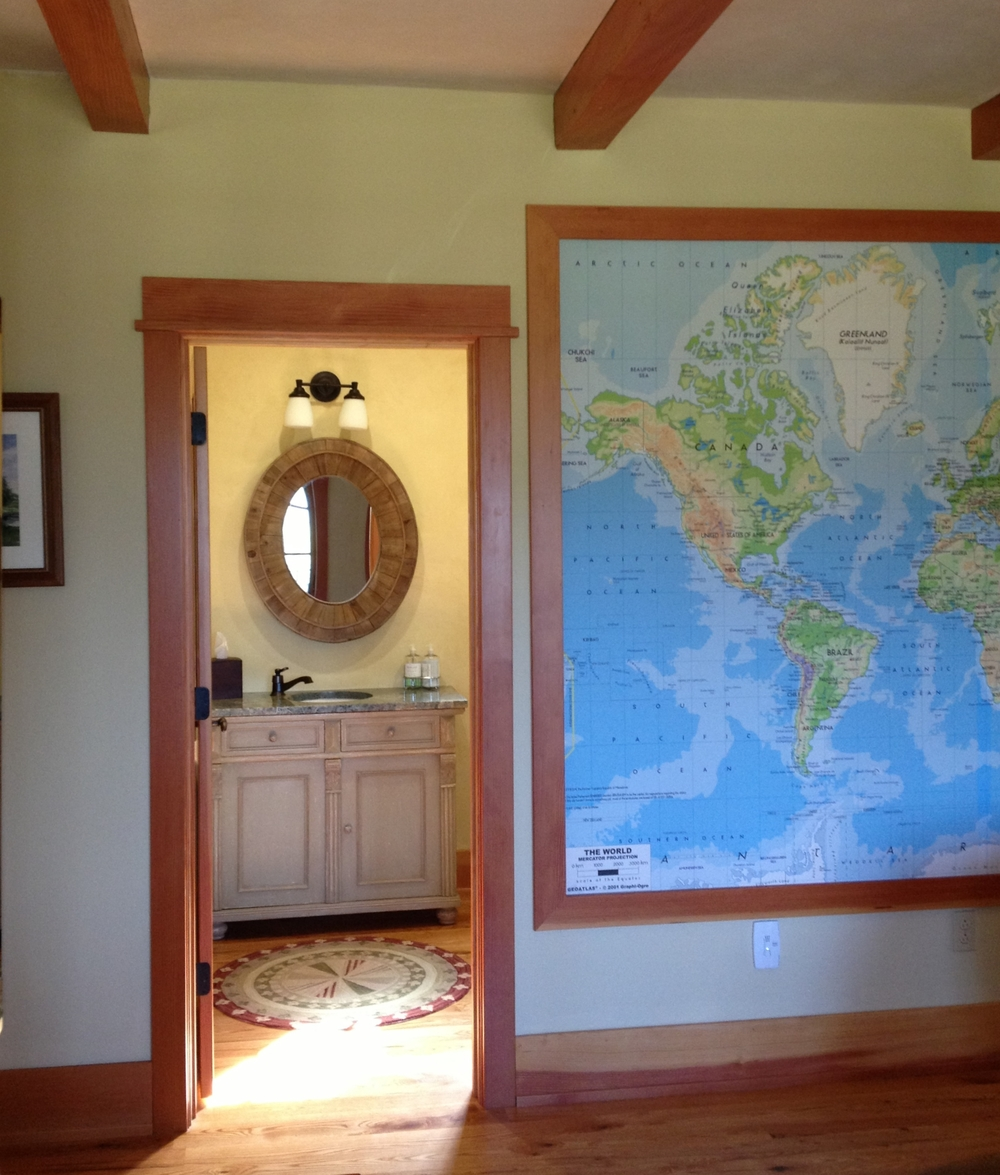 In this media room I designed for a well traveled family, I added a custom sized map of the world to one of the major walls.  It is a great conversation piece.