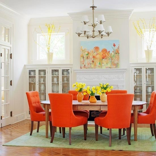These tufted hostess chairs really pop in this mostly white dining room.