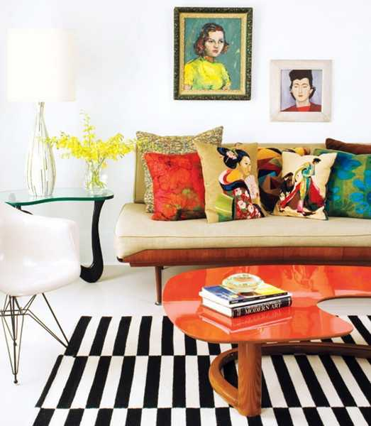Lacquered orange top on this modern table adds just the right amount of punch to this room.