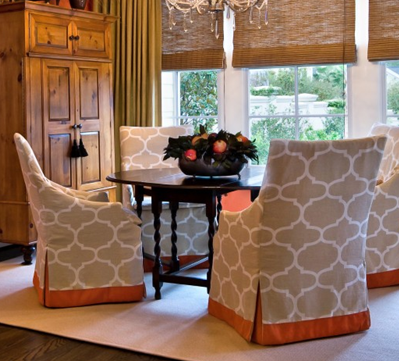 A little orange band and kick pleat insert goes a long way on these slip covered chairs.