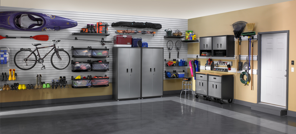 Customized to both the needs and hobbies of the homeowner, this garage is a breath of organizational fresh air!!