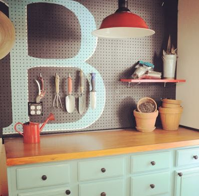 Add a punch of color and a personal touch to enliven your organized garage!