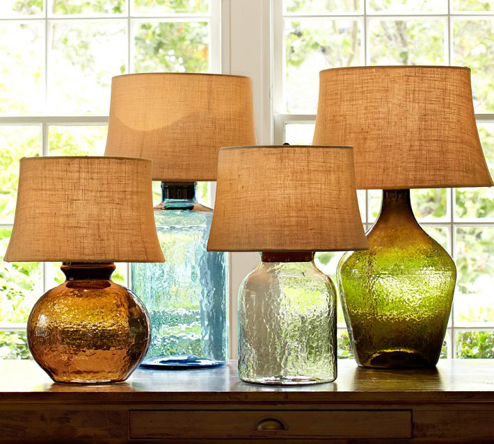 Lighting is an easy yet impactful way to introduce color, and colored glass, into a space. Whether it's table lamps, pendant lighting or a chandelier, they can go from a subtle glow to a brilliant splash of color.