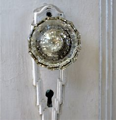 Okay, so it's technically not colored, but jewellike door knob exemplifies the magical, mesmerizing power of glass. I don't know whether I'd install it, or wear it!