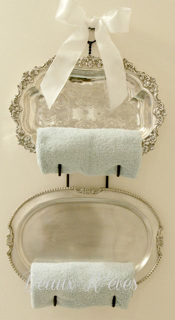 Add to the accessories by repurposing those silver trays in a dining room drawer as towel racks.