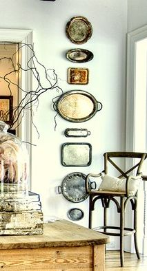 This collection of vintage silver trays provides unique yet personal wall decor.