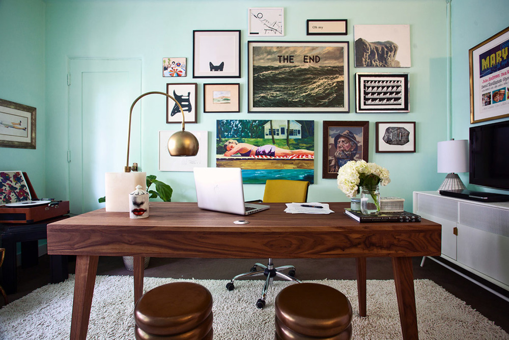 This gallery wall is perfectly playful and smart. Even the aqua wall in this home office provides the perfect backdrop for an irreverent art collection