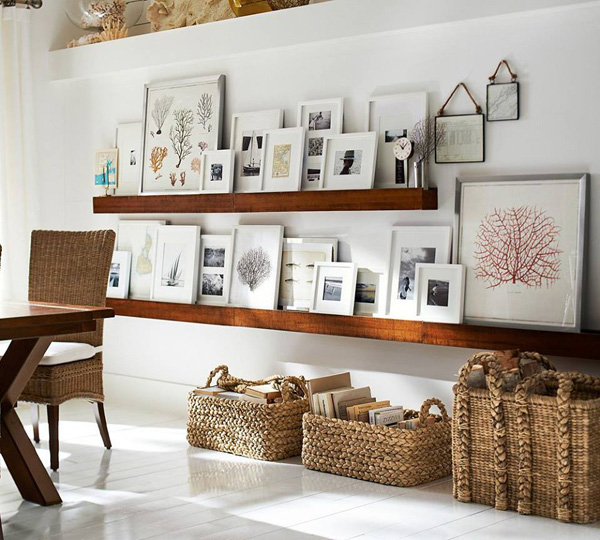 An interesting interpretation of the gallery wall! Using shelves provides versatility, and saves your walls!