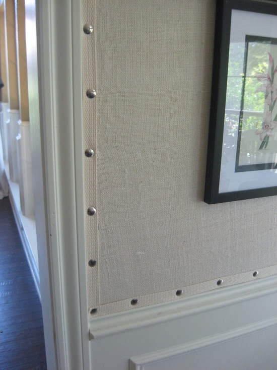 We love the crisp clean look of burlap applied above the wainscoting.  The trim with nail heads is an added bonus.