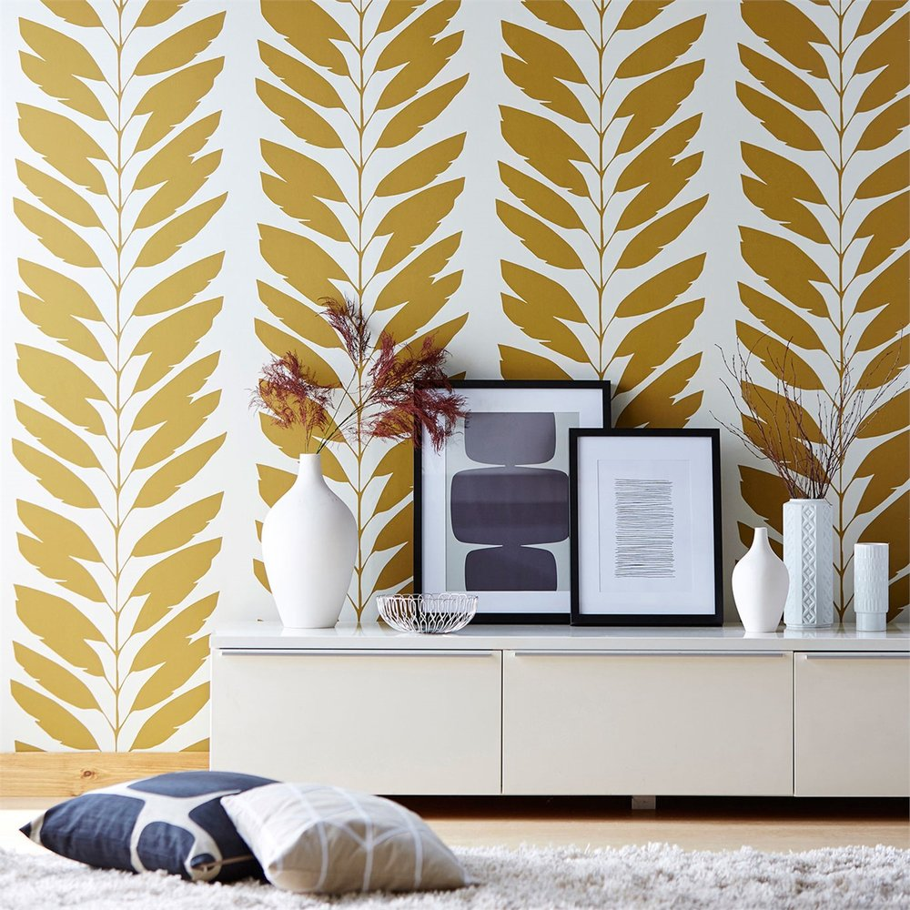 "Malva wallpaper by  Scion  takes artistic license with the repeating image of the leaves and branches, then punches it up with the color.  Shown here is ""cinnamon"" but available in yummy colors like ""Mist"" and ""Licorice""."