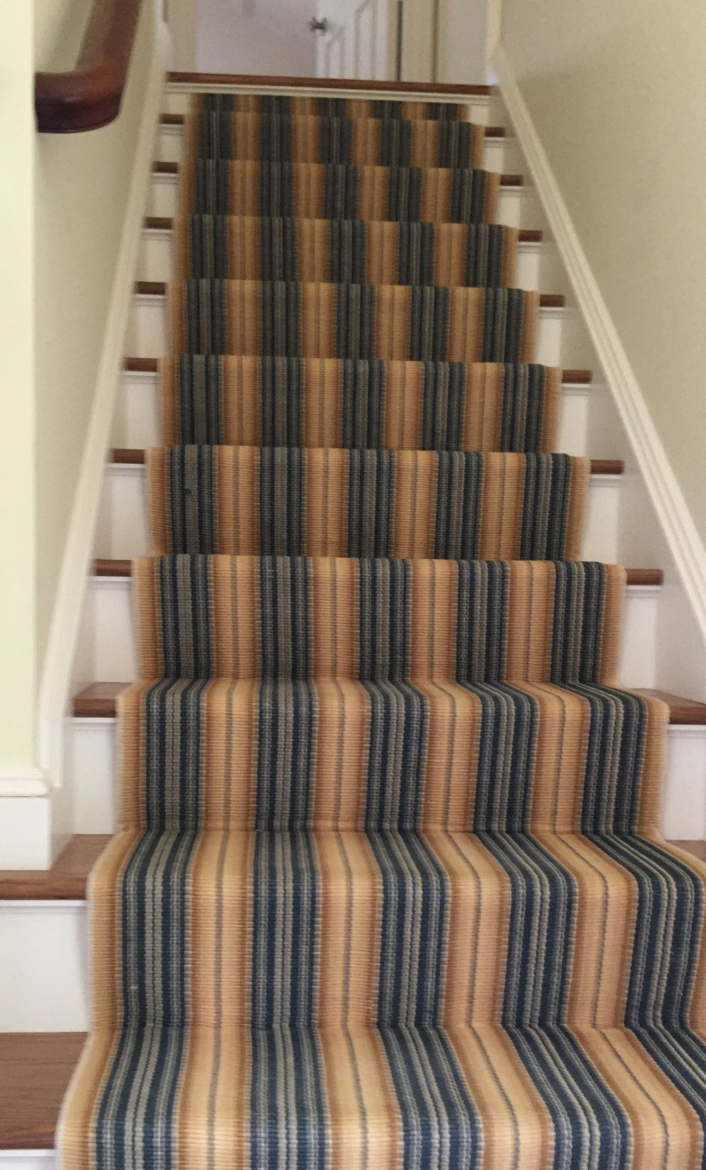 This cotton runner from  Dash and Albert  was a great way to liven up the stairwell.  We ordered 2 8' runners and had our installer run them up the stairs ending just below the top landing.