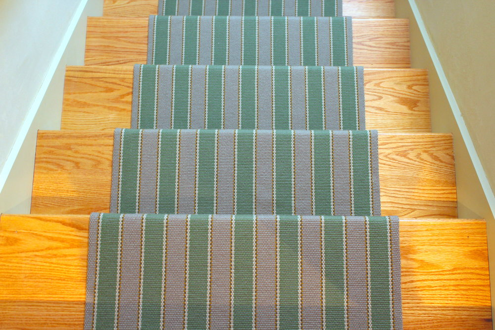 "The back stairs at this mountain home is jazzed up by this  Fleetwood Fox  wool runner.  We like to leave about 5""-6"" on either side of the runner to show off the tread."