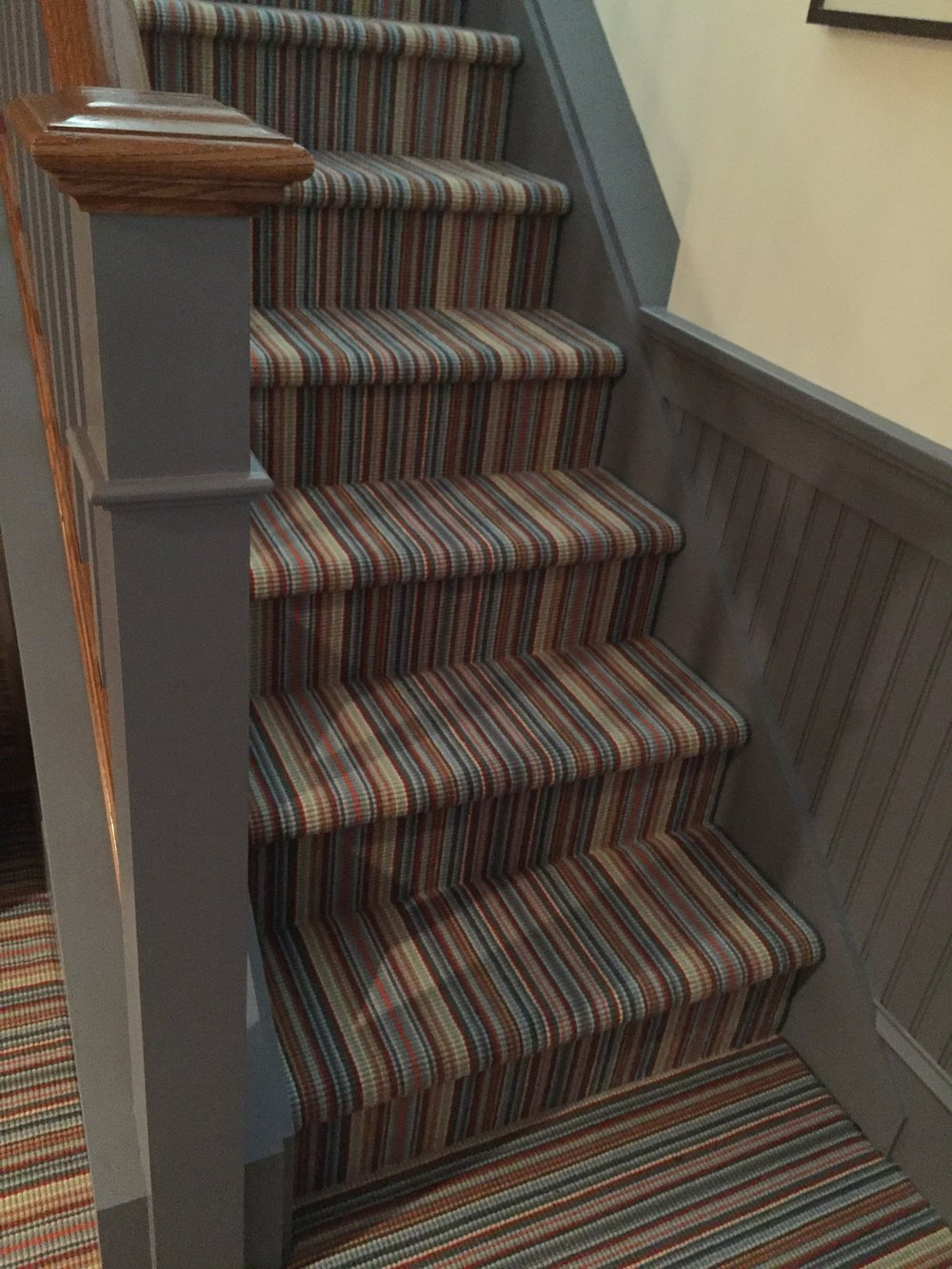 "We like this  Weave Tuft  carpet, too.  It is the same style and colorway as the first image in this blog!  See how different it can look in this application?  These are ""carpet grade"" stairs (for the budget conscious) so the carpet is installed ""wall to wall: And we have accented it with a gray painted trim."