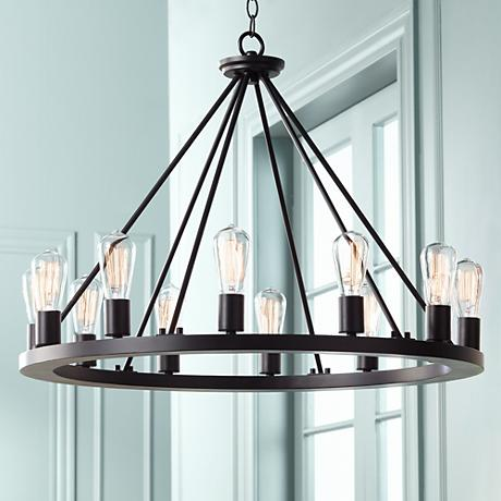 This chandelier is using halogen Edison style bulbs.