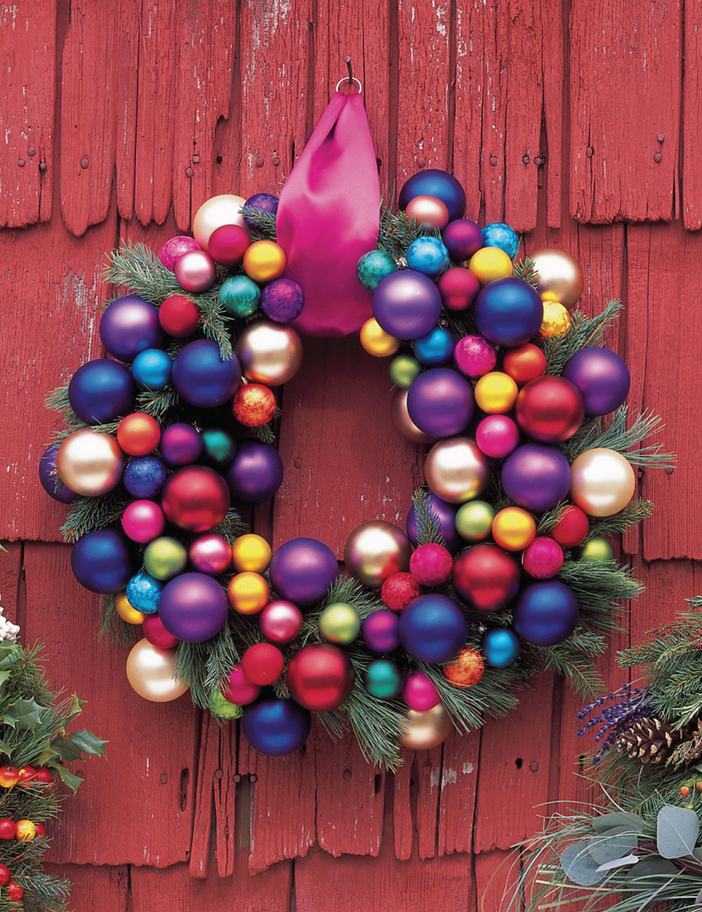 Good Housekeeping presented this colorful wreath recently.  I like the sprigs of greenery.