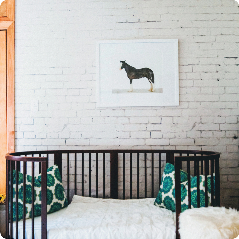 The  Wall Sticker Company  has produced a removable paper that looks like an old brick wall.  Pretty believealbe!