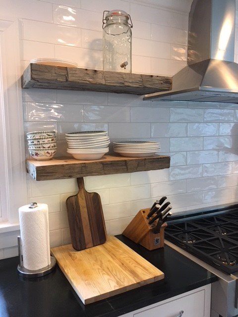 If you can handle open shelves, make sure they are securely installed.  Our builder installed steel posts in the wall that the shelves slide onto.  They can carry the weight of almost anything!