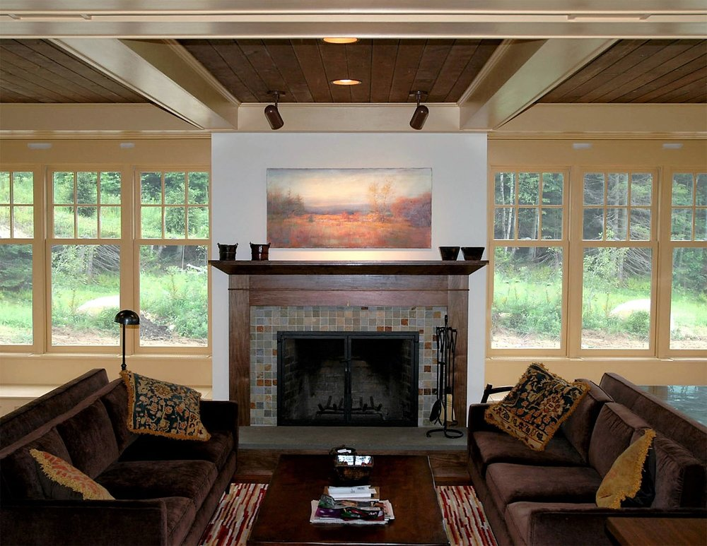 Here is a more modern take on a fireplace with lots of natural elements.  Although the trim is painted, we have kept the mantle natural.  The black walnut really is beautiful.  Although the ceiling is birch, we were able to stain it to be very close to the color of the black walnut.  The slate tile surround adds to the modern feel.