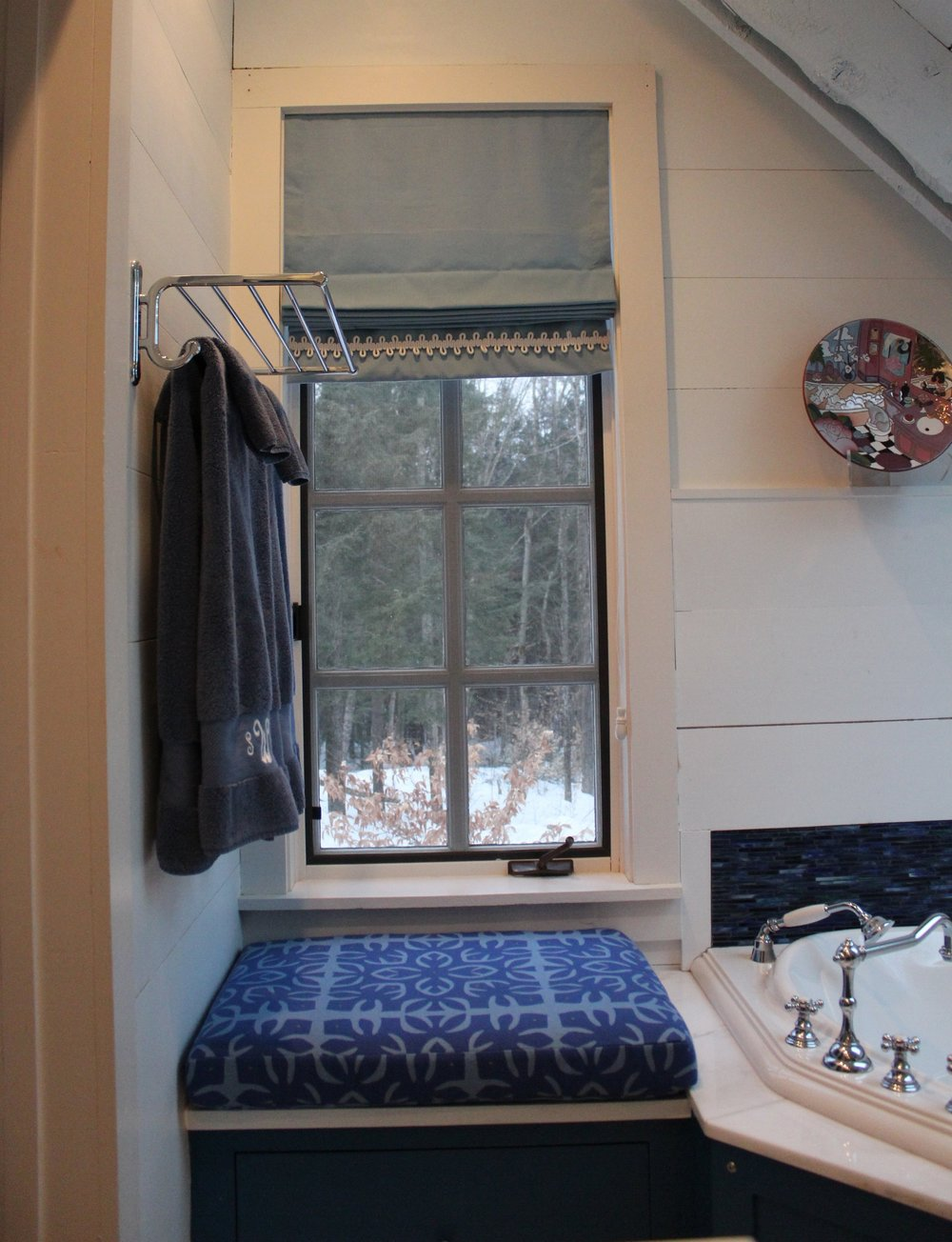 "In this renovated barn we added a window seat with cushion made out of indoor/outdoor fabric (from  Donghia ).  We also added a ""train rack"" for extra towel storage.  Notice that we added a back splash behind this stand alone tub.  It is attractive and will save the walls from water damage!"