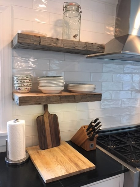 Great team work with the builder on this installation!  He installed metal posts into the studs to hang the shelves, installed the hand molded subway tiles, then slide the custom shelves on to the posts for a clean look.  What do you think?