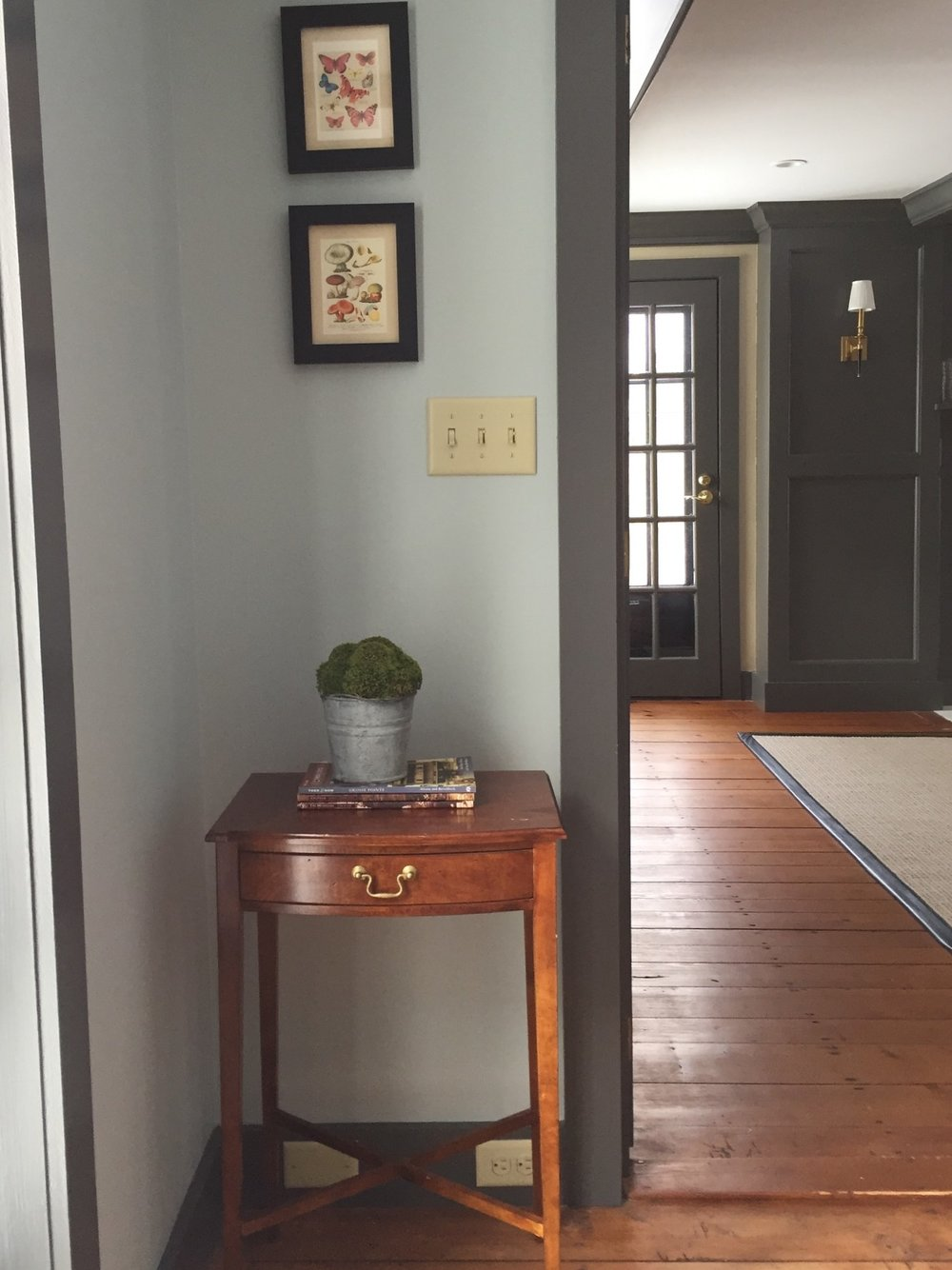 The walls are  Ben Moore's  Woodlawn Blue and the trim is Kendall Charcoal.  It easily brings you into the office where the trim is Kendall Charcoal with Muslin walls.