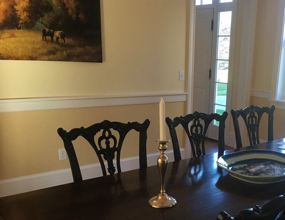 The two tone walls in this dining room help to create an intimate setting for a dinner party.  I like to use a darker color below a chair rail.  It helps to ground the space.