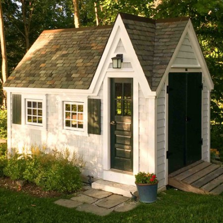This adorable doll house is available through Jamaica Cottage Shops.  We love the double doors on the end. They make storing larger items so much easier.