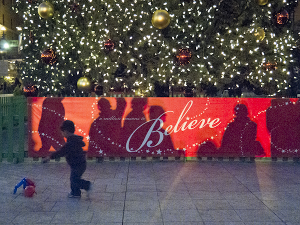 Boy running in front of the Christmas Tree at Union Square. San Francisco, CA./ ©Stella Kalaw