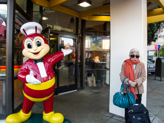 Lady next to Jollibee Mascot on 4th Street. San Francisco, CA/ ©Stella Kalaw