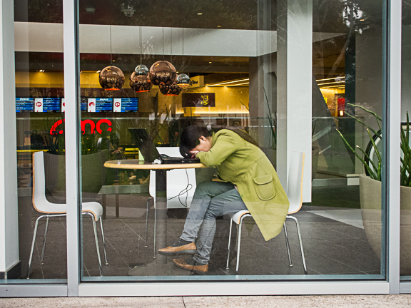 Exhausted Girl in Lime Coat at the Metreon. San Francisco, CA/ ©Stella Kalaw