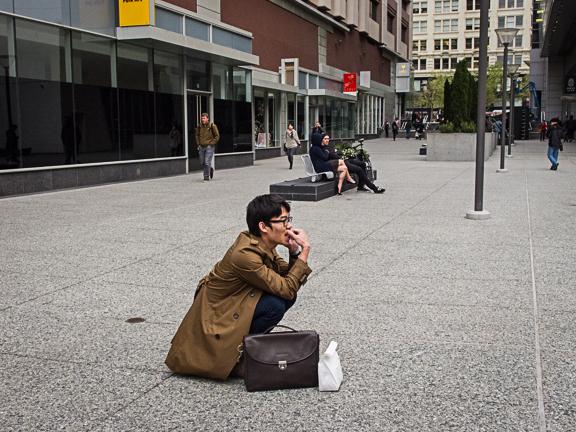 Man Crouched with his Phone. Yerba Buena Lane.San Francisco, CA/ ©Stella Kalaw