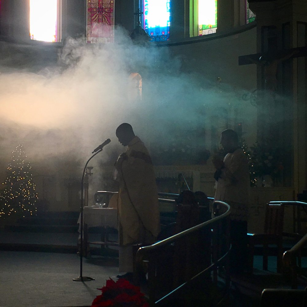 Smoke from the incense lingered above Father Raphael during New Year's Day mass. St. Joseph the Worker Parish Church. Berkeley, CA.