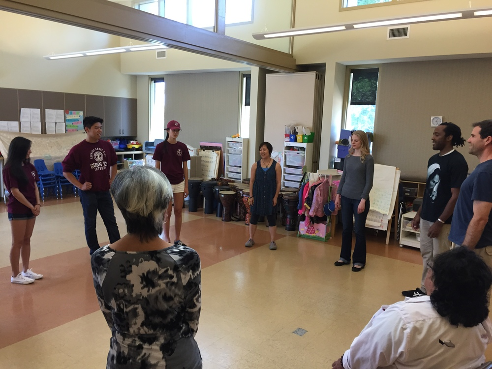 "Coke Tani (center) leads ""Experience of Art"" participants in a movement-based workshop"