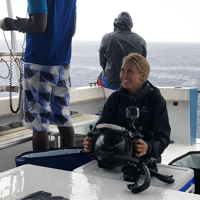 Changing camera settings in Dominica where we were photographing sperm whales. Hard to imagine that last weekend I was trying to get home after almost being swept away by a river. I guess the rain in the background here should have been our first warning. . . . . . #goexplore #expedition #ocean #underwaterphotography #underwater #nauticam #whalewatching #dominica #explore #girlswhofish #nikon #upclose #adventure #travel #journey #gettingready
