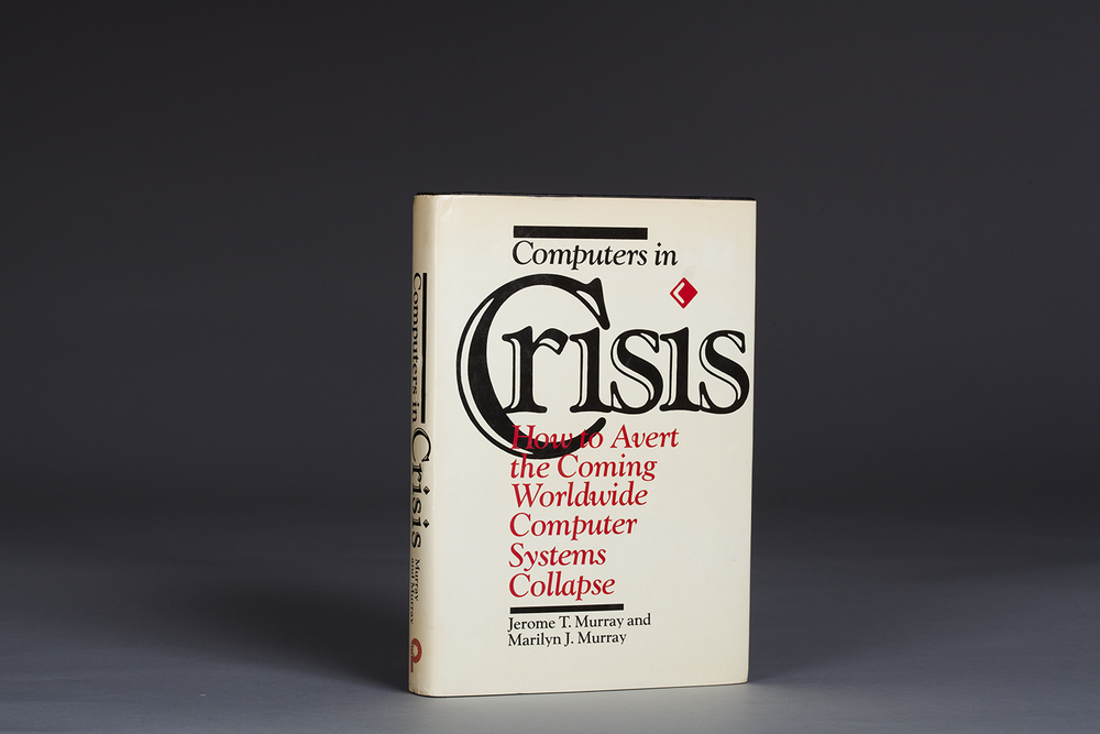Computers in Crisis by Jerome T. Murray & Marilyn J. Murray (1984) was the first book published about the computer date problem later known as Y2K.