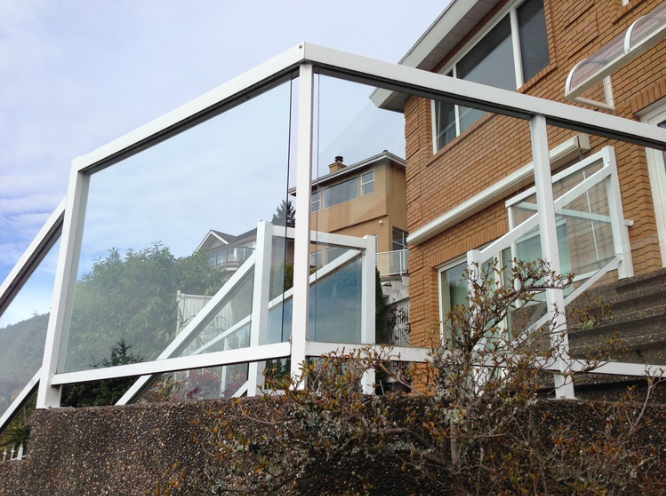 Temper clear glass railing with aluminum frame, British Properties, West Vancouver, BC.