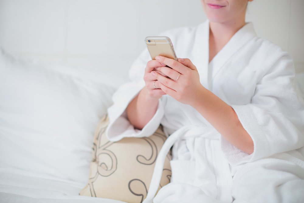 woman-lounges-in-bathrobe-with-phone_4460x4460.jpg