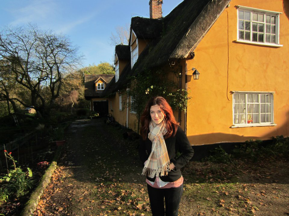 mary goodchild outside Maria's cottage.
