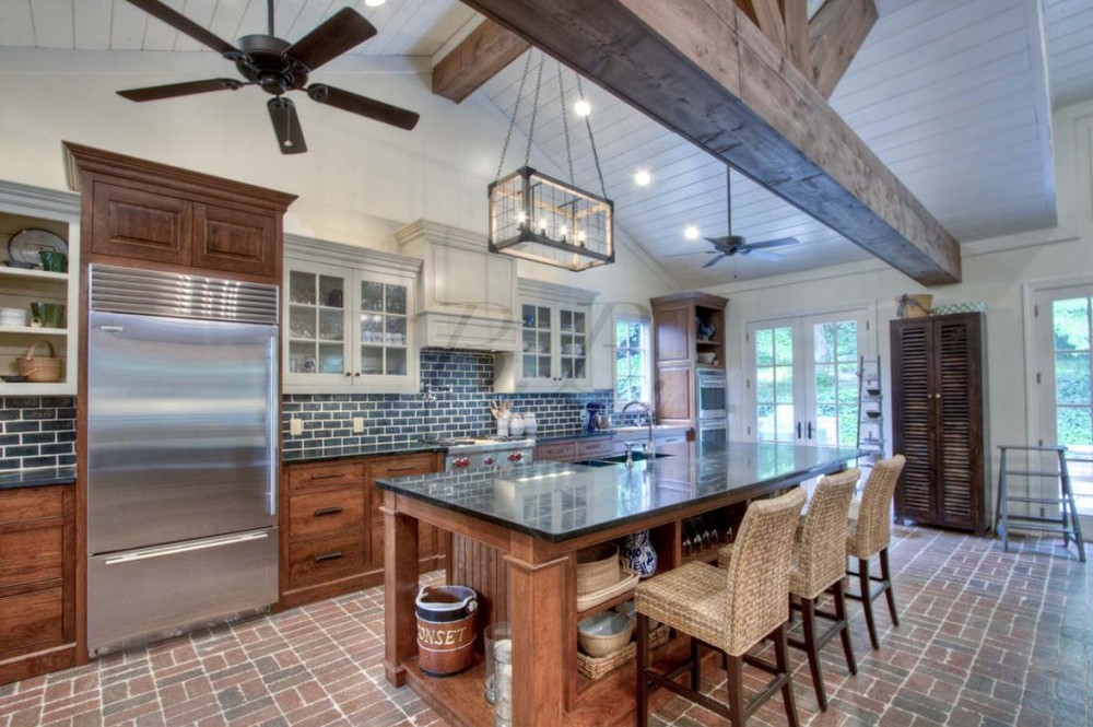 That island is perfect for having people hang out in the kitchen, which is  where everyone always gathers anyway.