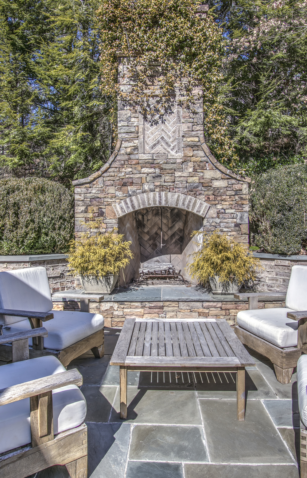 outdoor fireplace and grilling area