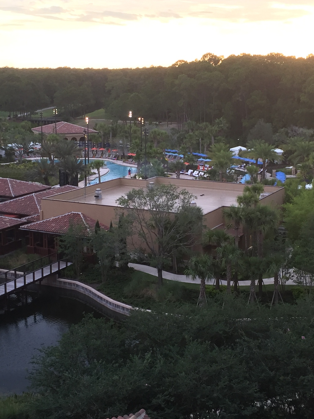 This is a view from our room to one of the pools where they were showing a movie for the kids! - Kids... I mean, we ALMOST went.