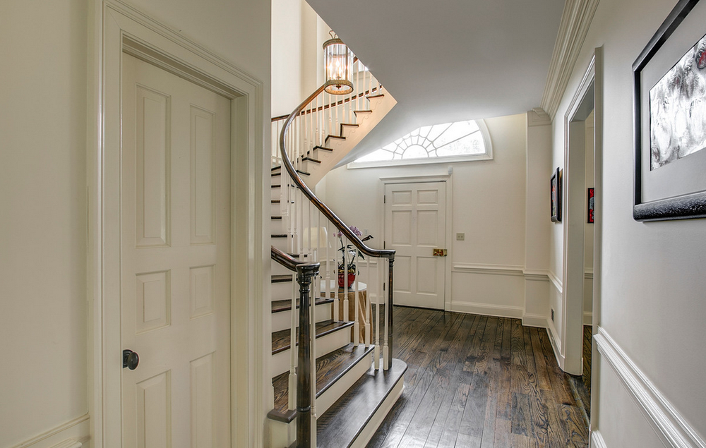 Foyer with curved staircae