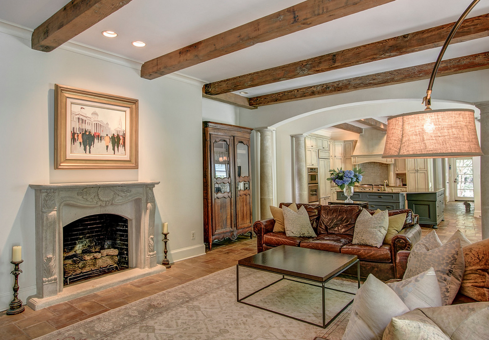 Living room with beams, fireplace and brick floors
