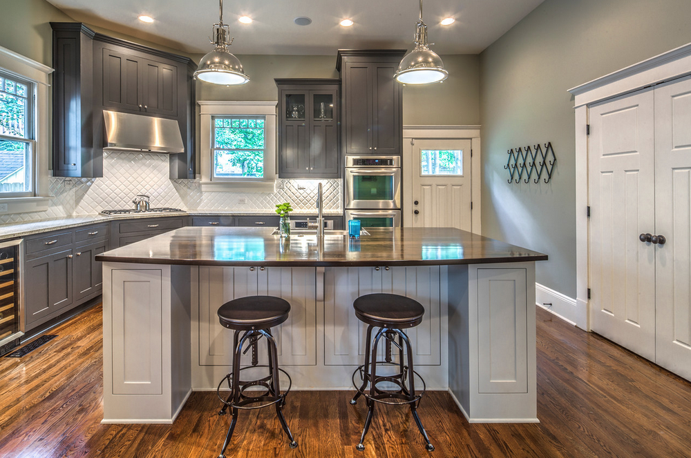 Renovated craftsman style bungalow in inman park hits the for Dark kitchen cabinets light island