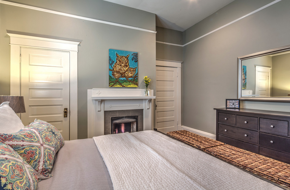 Craftsman master bedroom with fireplace