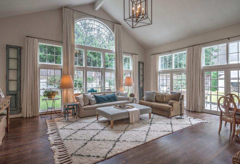two story family room with checked rug