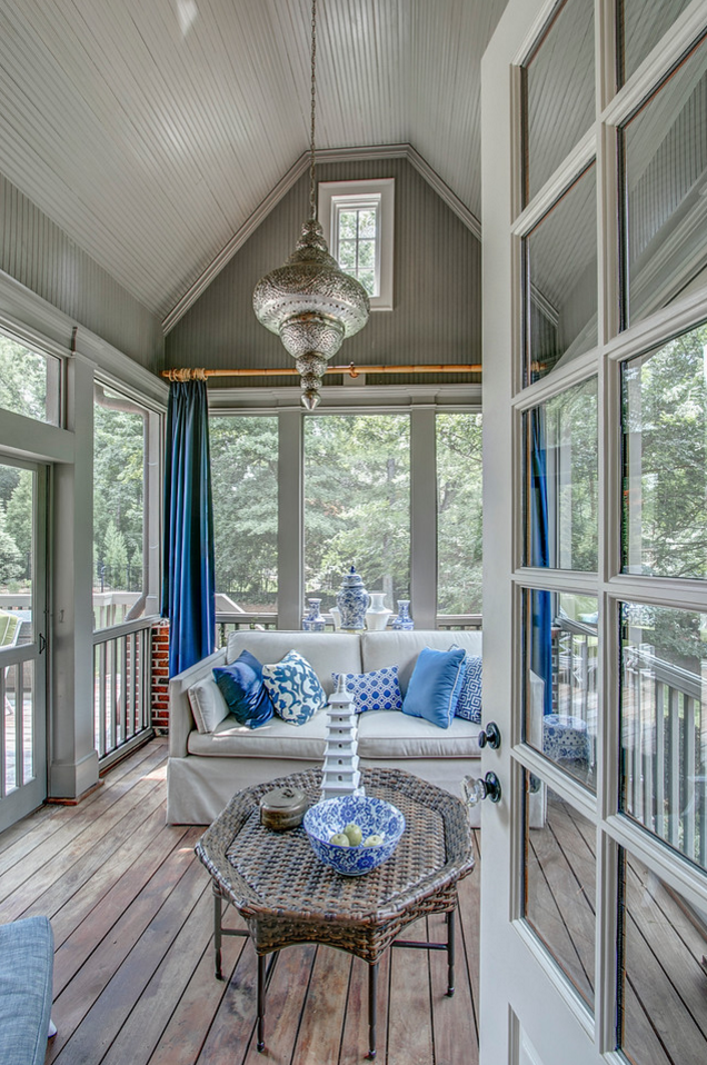 Screen porch with curtains