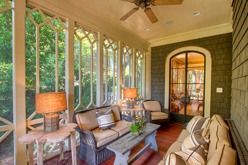 screen porch with iron doors