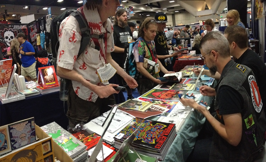 Signing at the Last Gasp booth