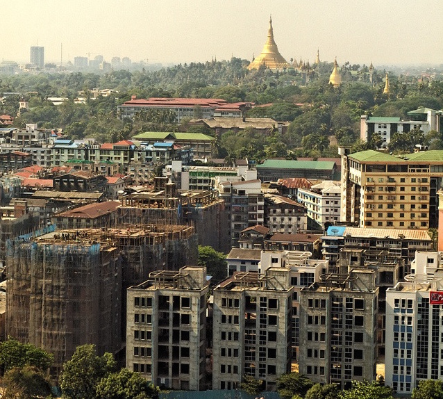 A mix of new and old in Yangon (Photo by PeterBeeJeff).